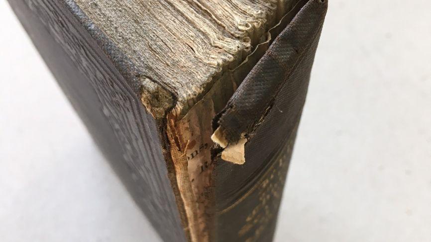Cloth covered binding repair